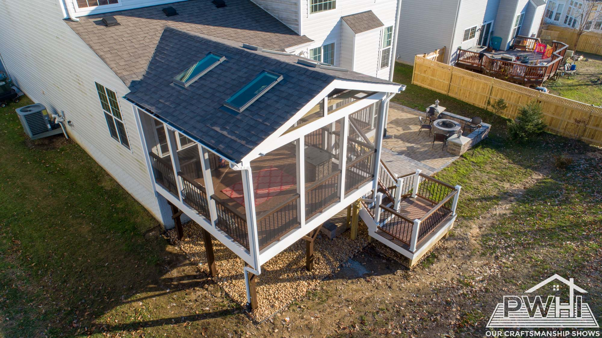 Home with outdoor sunroom aerial view