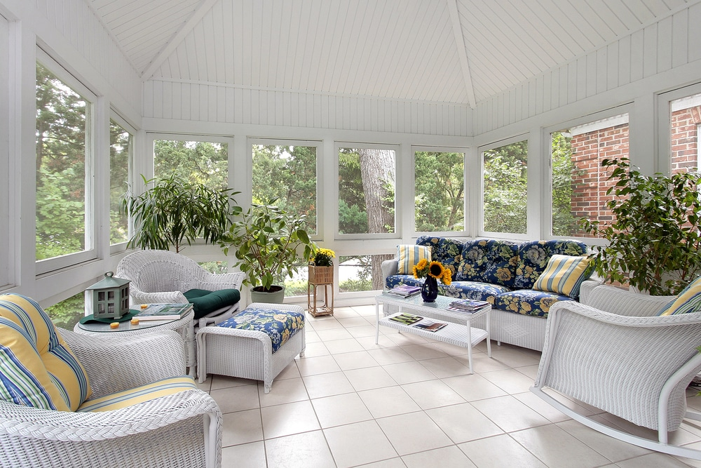 How to winterize a screened-in porch with couch and white tile floor image